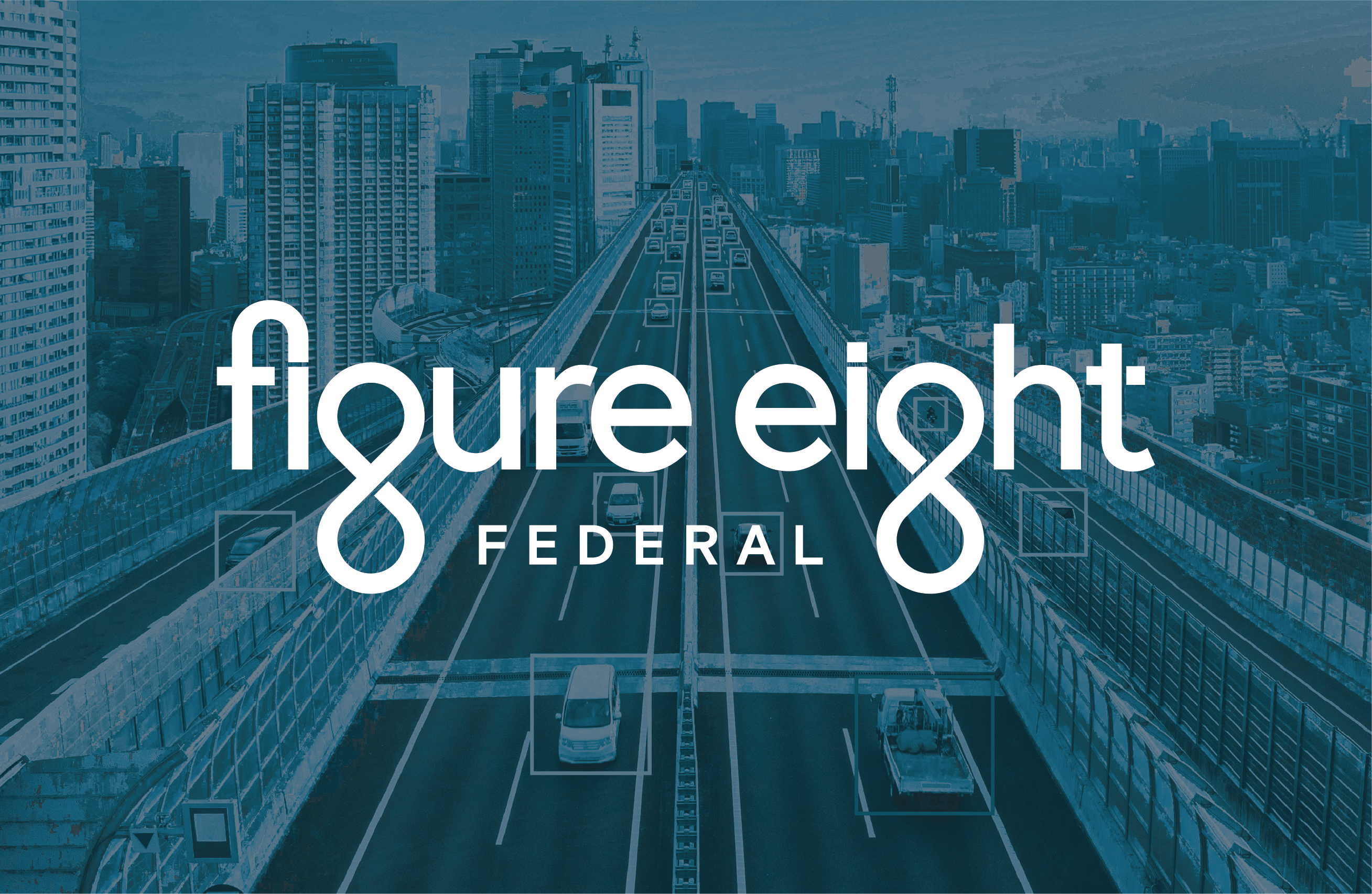 Figure Eight Federal logo overlaying an image of cars on the highway with bounding boxes over each vehicle.